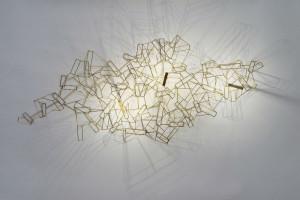 © GIL. Designer : Eric de Dormaël Applique LED, laiton et acier.