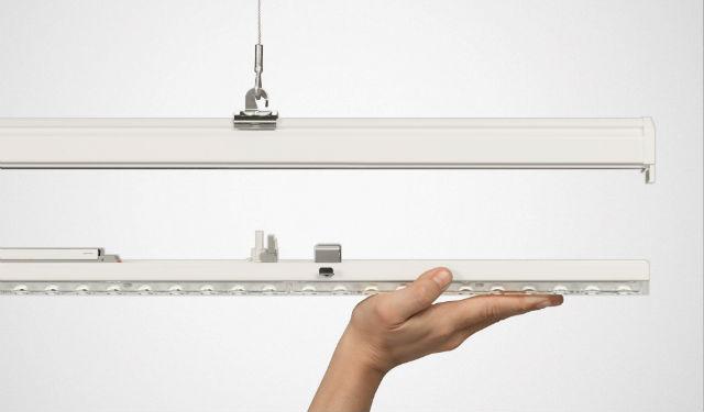 © Trilux, E-Line – Une rénovation en un tour de main : une ligne continue E-Line T5/T8 conventionnelle peut être remplacée en seulement 44 secondes par la version LED hautes performances. Une nouvelle installation est également très rapide à réaliser.